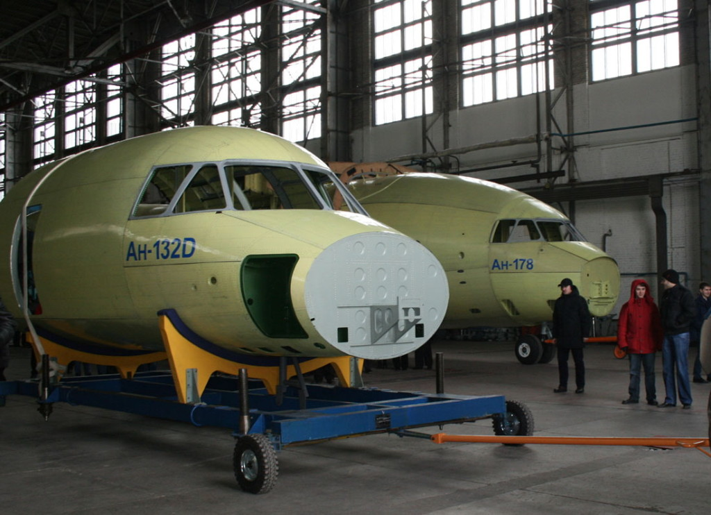 The completed fuselage of the second AN-178 transport aircraft (right) is partly hidden by the fuselage of the first AN-132 demonstrator at ANTONOV's main assembly plant in Ukraine (ANTONOV photo)