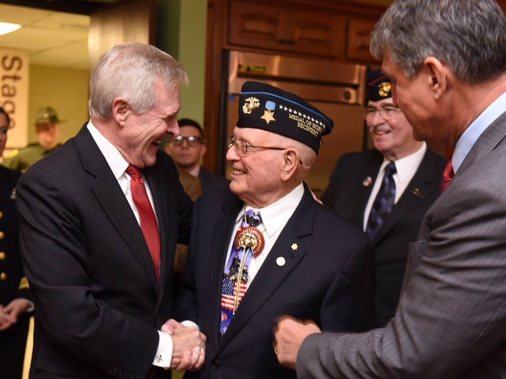 SECNAV Ray Mabus greets Medal of Honor recipient Hershel Woody Williams before naming T-ESB-4 in his honor