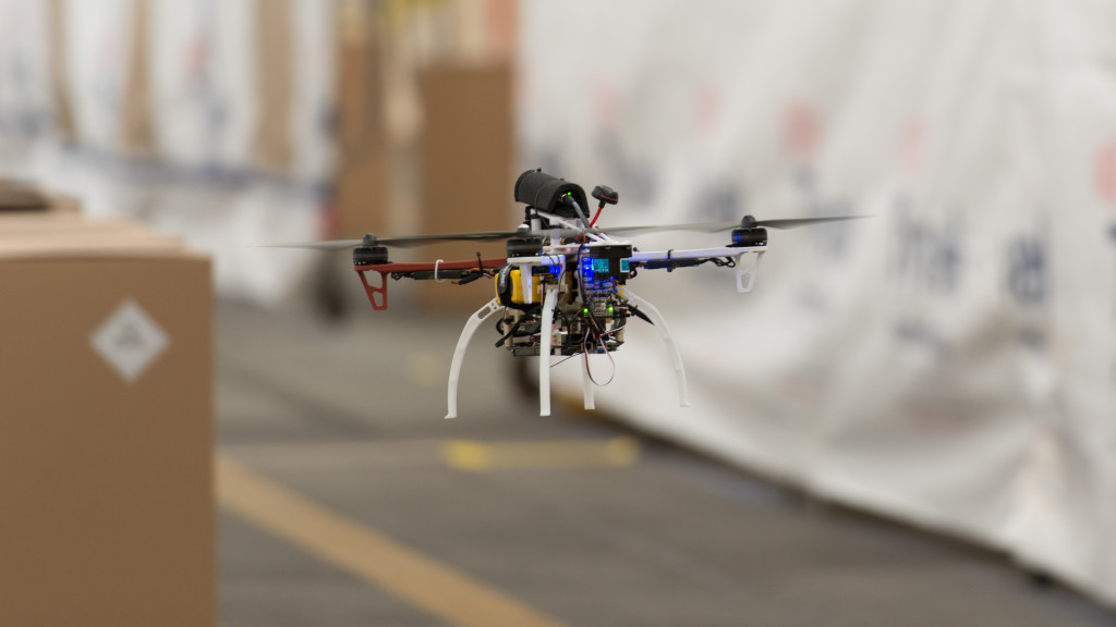 A FLA quadcopter self-navigates around boxes during initial flight data collection using only onboard sensors/software