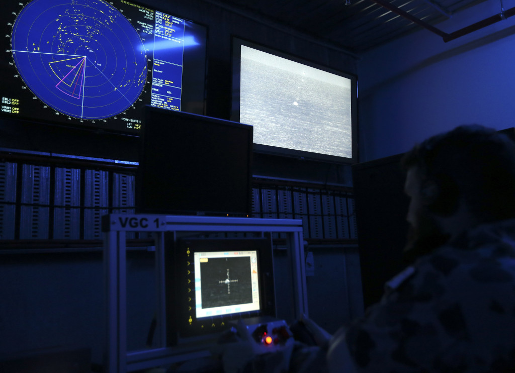 Leading Seaman Electronics Technician Jacob Ward at the firing panel of the Mk-25 Mod 2 25-mm Typhoon during the weapons certification firing with the radar and Electro Optical Tracking System (EOTS) infrared on display at West Head Gunnery Range, Flinders, Victoria
