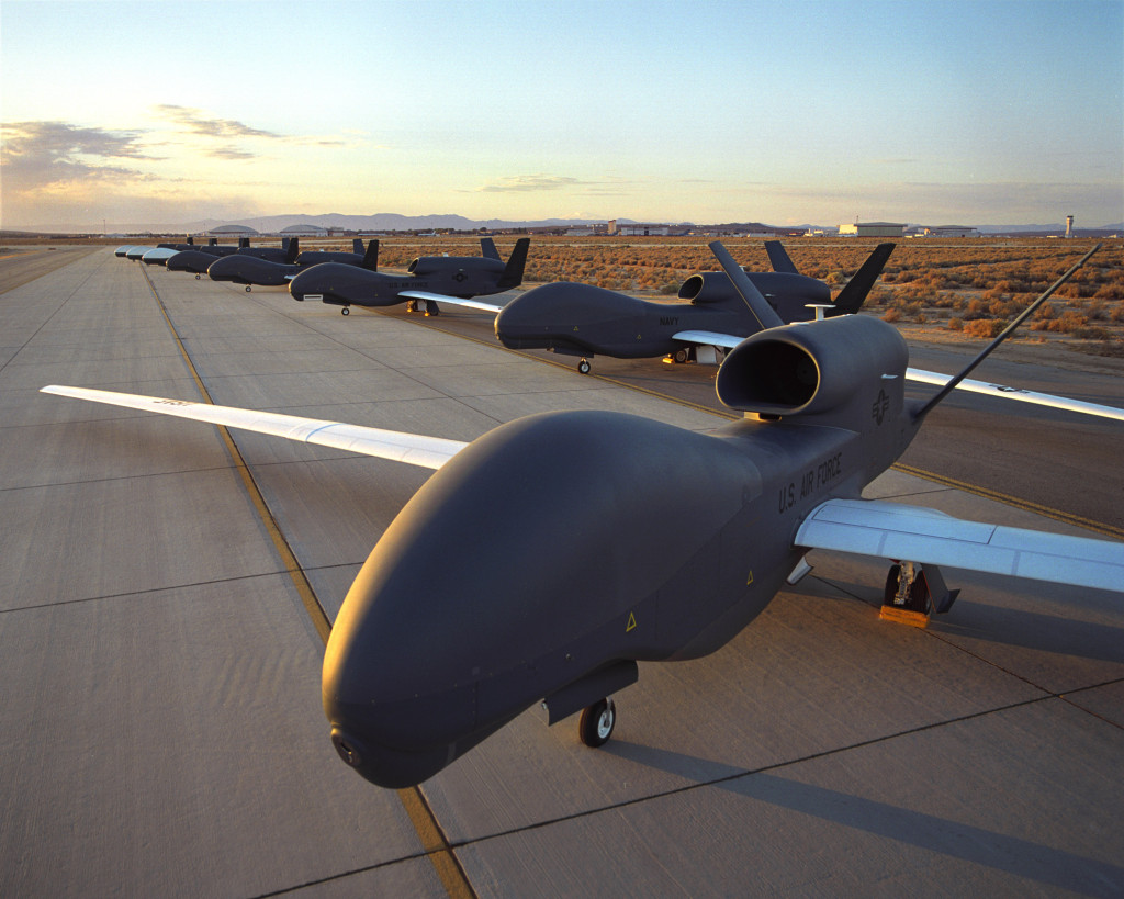 Front view of eight RQ-4 Air Force in front and Navy in foreground