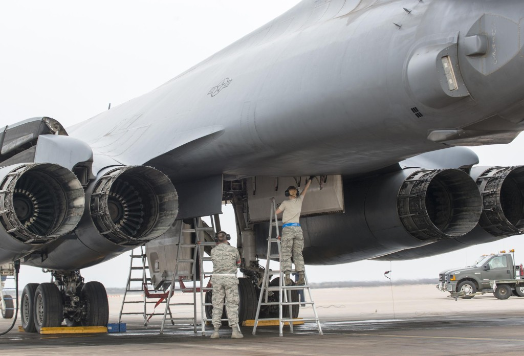 Airmen assigned to the 7th Maintenance Group prep a B-1B Lancer's bomb bay for a Joint Air-to-Surface Standoff Missile February 21, 2016, at Dyess Air Force Base, Texas, during a B-1 Combat Mission Effectiveness Exercise (U.S. Air Force photo by Airman 1st Class Austin Mayfield/Released)