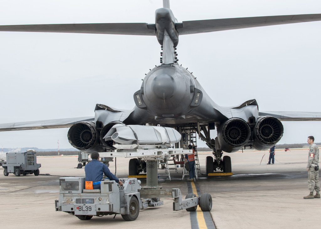 Airmen assigned to the 7th Maintenance Group load an inert Joint Air-to-Surface Standoff Missile (JASSM) at Dyess Air Force Base, Texas, in a B-1B Lancer February 21, 2016, during a B-1 Combat Mission Effectiveness exercise (U.S. Air Force photo by Airman 1st Class Austin Mayfield/Released)