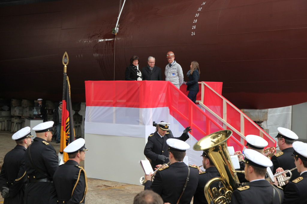 Dr. Gabriele Haseloff, wife of the premier of the state of Saxony-Anhalt after which the frigate has been named, performed the christening ceremony