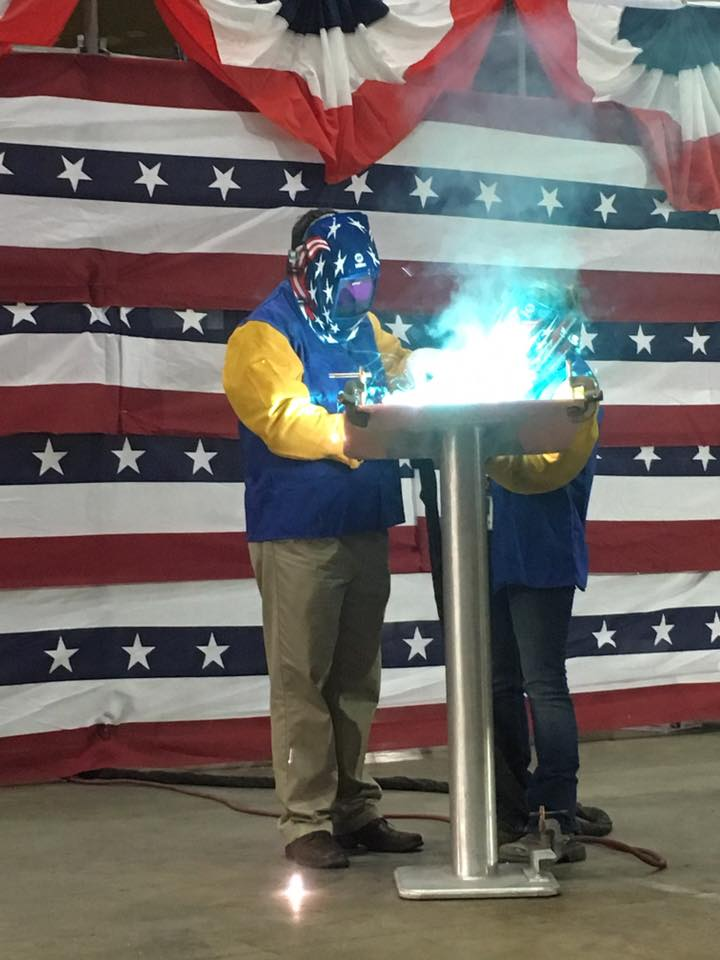 Mayor Nicholls was assisted by Austal USA A-Class welder, Courtney Cagle