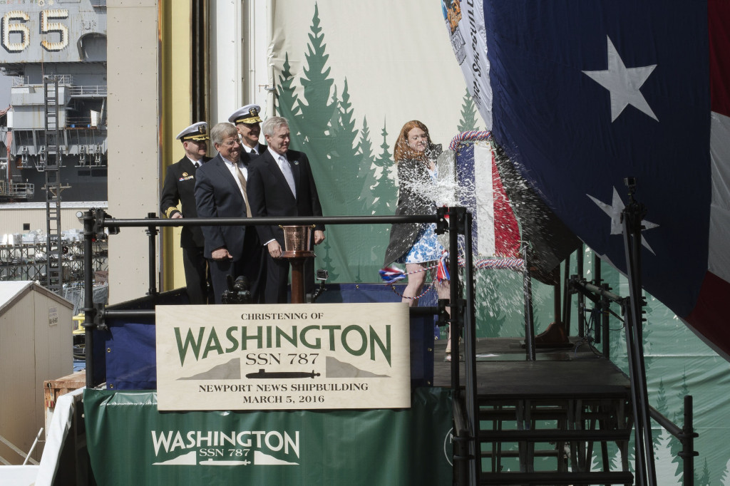 Elisabeth Mabus, daughter of Secretary of the Navy Ray Mabus, smashed a bottle of sparkling wine across the bow of Virginia-class submarine Washington (SSN-787), christening the submarine named for the Evergreen State. Washington will be the seventh Virginia-class submarine to be delivered by Newport News Shipbuilding (Photo by John Whalen/HII)