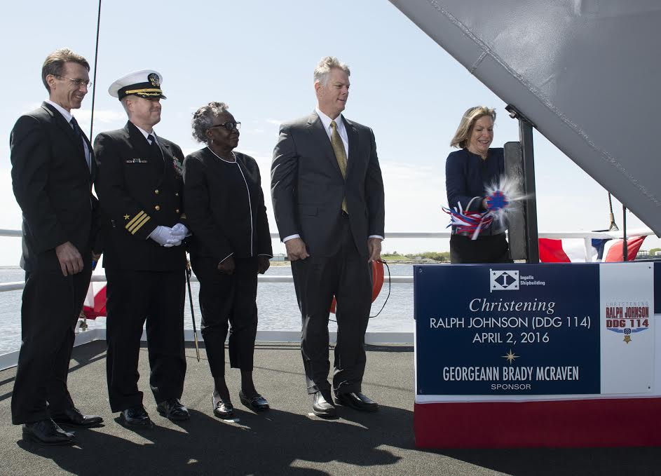 Ship Sponsor Georgeann McRaven christens DDG-114, the destroyer named for Medal of Honor recipient Ralph Johnson. Also pictured (left to right) are Assistant Secretary of the U.S. Navy Sean Stackley; Commander Jason Patterson, the ship's prospective commanding officer; Helen Richards, Ralph Johnson's sister; and Ingalls Shipbuilding President Brian Cuccias (Photo by HII)