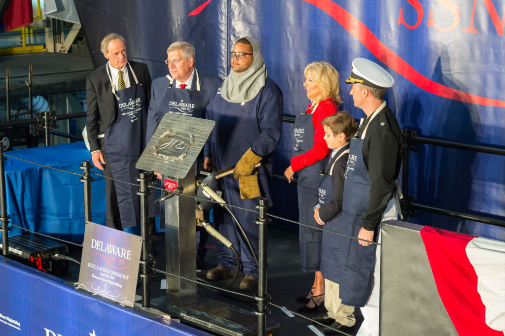 Ship Sponsor Dr. Jill Biden's initials were welded onto a steel plate that will be permanently affixed to the submarine USS Delaware (SSN-791), symbolizing her lifelong relationship with the shipbuilders and crew (Photo by Chris Oxley/HII)