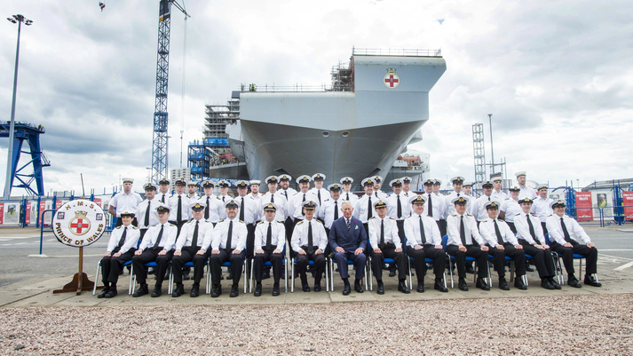 HRH Prince Charles places the final section of HMS Prince of Wales (R09)