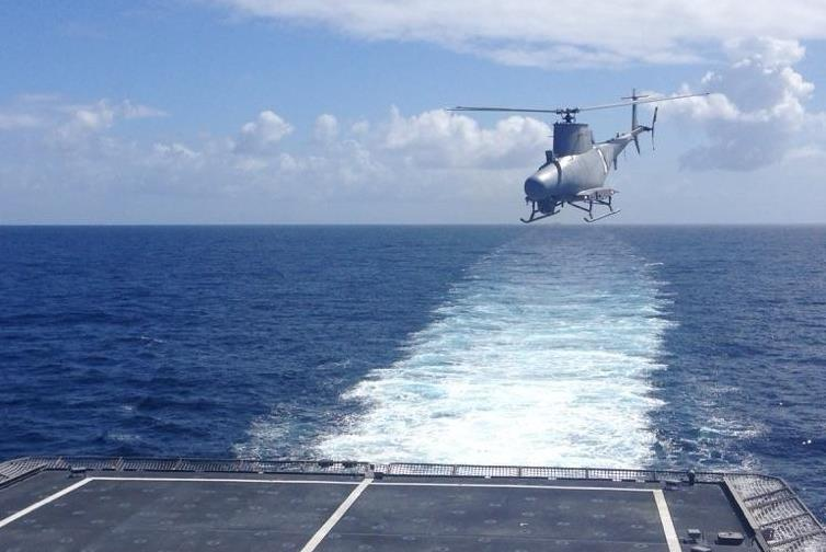 An MQ-8B Fire Scout conducts flight operations in preparation for deployment with USS Coronado (LCS-4) in June 2016. The unmanned helicopter deployed with a new search radar that will increase situational awareness for the ship's crew in maritime and littoral environments (U.S. Navy photo)