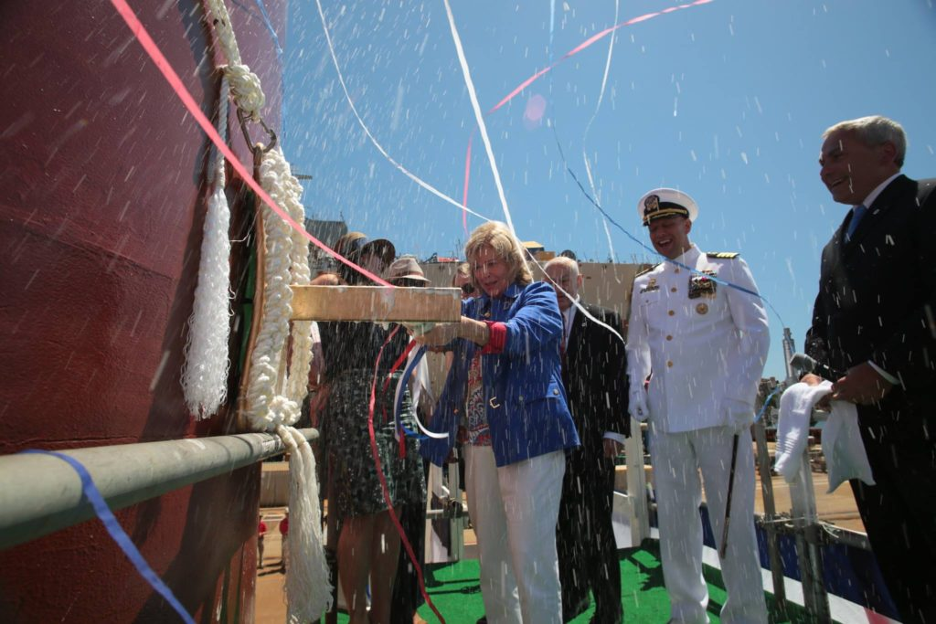 Sally Monsoor, mother of Michael Monsoor and sponsor of the ship named in his honor, christens the vessel on Saturday at General Dynamics Bath Iron Works in Maine