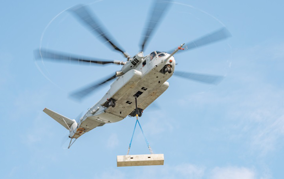 The Sikorsky CH-53 King Stallion lifts a 27,000 pound/12,247 kg external load