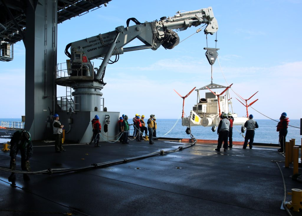 Sailors and Civil Service Mariners attached to Military Sealift Command's USNS Lewis B. Puller (T-ESB-3) and Sailors assigned to Helicopter Mine Countermeasure Squadron 15 (HM-15) recover a Mark 105 Mine Countermeasure Sled (U.S. Navy Photo by Bill Mesta/Released)