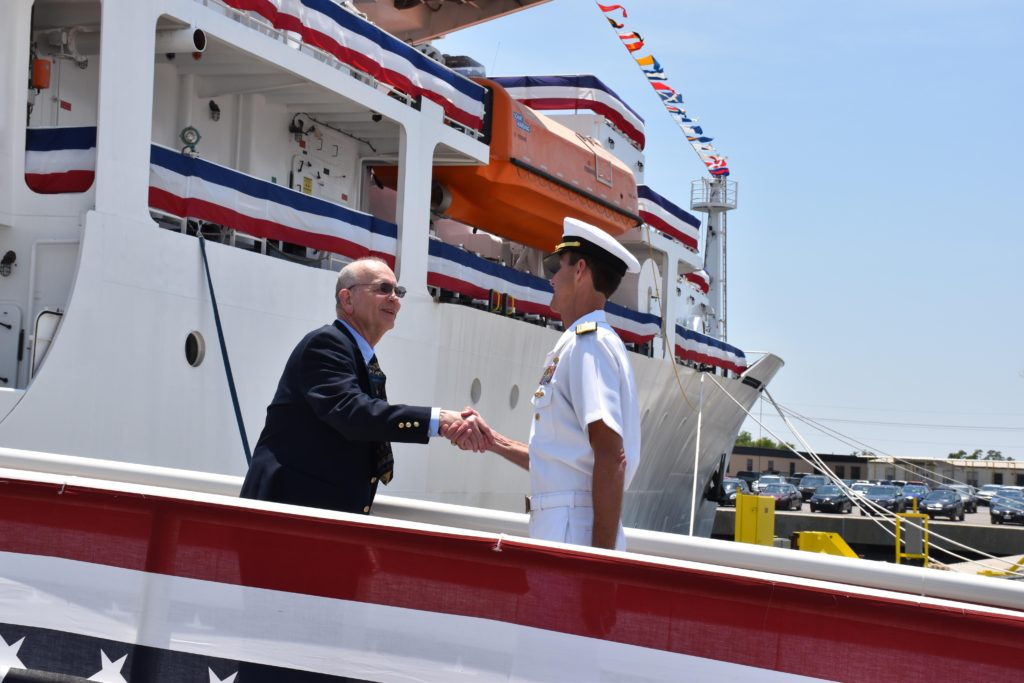 Ed Gent, Naval Oceanographic Office engineer, greets Rear Admiral Timothy Gallaudet, commander of the Naval Meteorology and Oceanography Command and Oceanographer and Navigator of the U.S. Navy, as Gallaudet boards USNS Maury (T-AGS 66), the Navy's newest oceanographic survey ship. The Naval Oceanographic Office, under the operational command of the Naval Meteorology and Oceanography Command, uses the ship to collect oceanographic data for U.S. Navy operations