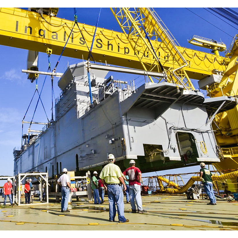 Ingalls Shipbuilding lands the 700-ton deckhouse on the amphibious assault ship USS Tripoli (LHA-7) on July 9 (Photo by Lance Davis/HII)