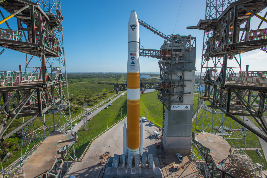 In preparation for launch, the Mobile Service Tower is rolled back from a Delta IV rocket carrying the AFSPC-6 mission