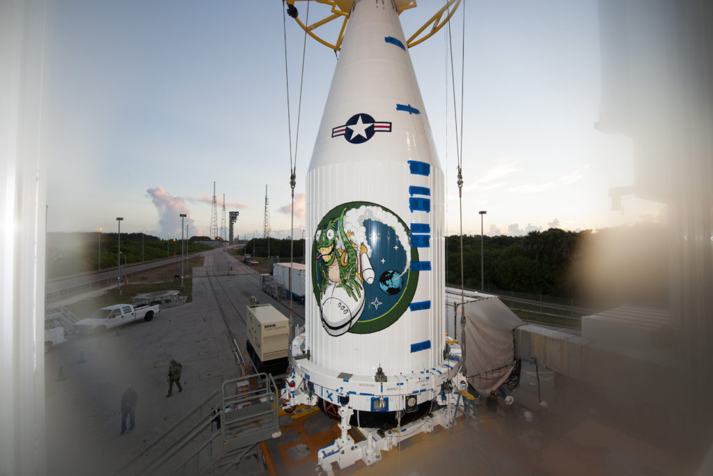 In preparation for launch, the NROL-61 payload for the National Reconnaissance Office is mated to an Atlas V rocket at the Vertical Integration Facility (ULA/Tony Gray)