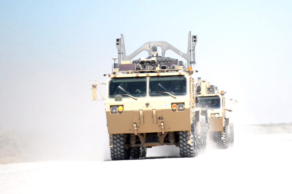 At Fort Bliss, Texas, October 14, 2016, one tactical vehicle, with a driver, is followed automatically by another, without input from the passenger behind the wheel. The «leader-follower» vehicle concept is being evaluated during the Army Warfighter Assessment 17.1 at Fort Bliss. In practice, multiple vehicles in a convoy could be controlled by only one vehicle, the lead vehicle, while the follow-on vehicles remain driverless. Without the need for those additional drivers, there would be fewer Soldiers involved in the convoy and less risk of loss of life in the event the convoy is attacked (Photo Credit: C. Todd Lopez)
