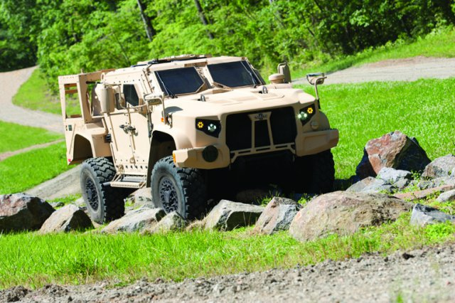 An Oshkosh Defense prototype of the Joint Light Tactical Vehicle negotiates an off-road demonstration course at Quantico, Virginia, in June 2013. The Oshkosh version beat out JLTV prototypes there from AM General and Lockheed Martin (Photo Credit: Courtesy Oshkosh Defense)