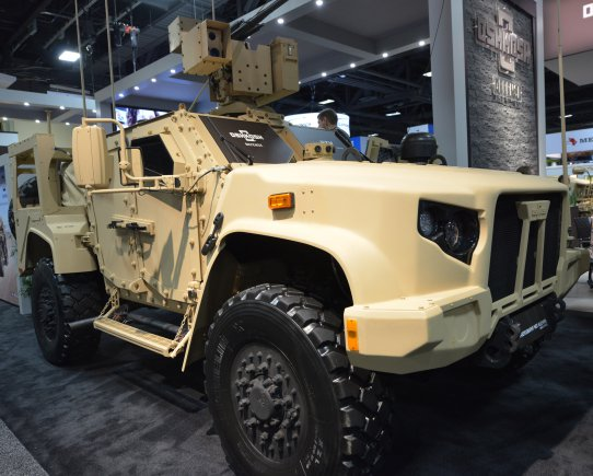A Joint Light Tactical Vehicle production model is displayed by Oshkosh on the floor of the AUSA Annual Meeting and Exhibition in the Washington Convention Center October 4, 2016 (Photo Credit: Gary Sheftick)
