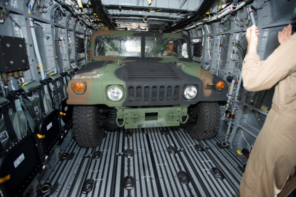 U.S. Marine Corps aircrew load the King Stallion's High Mobility Multipurpose Wheeled Vehicle cargo with ease