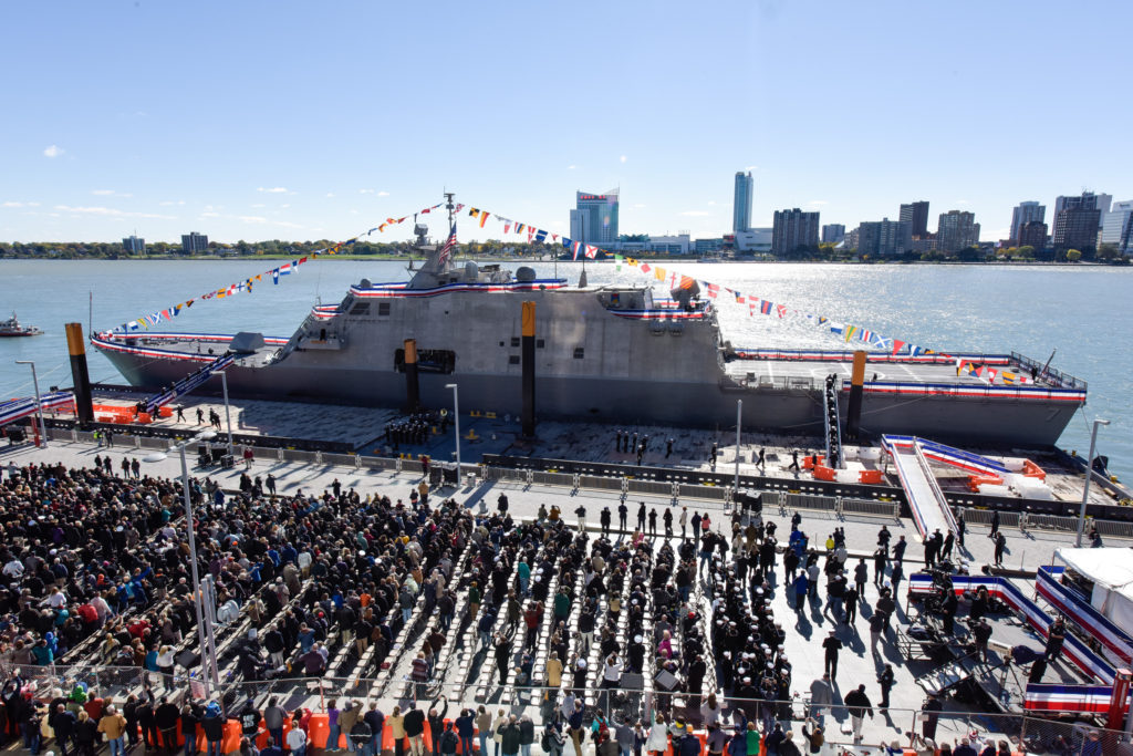 Sailors assigned to the Freedom-variant littoral combat ship USS Detroit (LCS-7) man their ship and bring her life during the commissioning ceremony on the Detroit River on October 22 (Photo credit: Lockheed Martin)