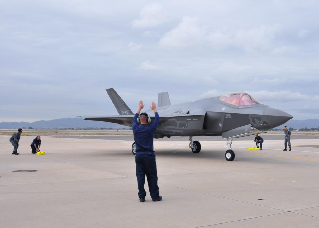 Lockheed Martin and Japanese Air Self-Defense Force personnel work together to taxi in the arrival of the first foreign military sales F-35A onto the 944th Fighter Wing ramp November 28, 2016, at Luke Air Force Base, Arizona. The arrival marked the next step for the international F-35 training program (U.S. Air Force photo/ Technical Sergeant Louis Vega Jr.)