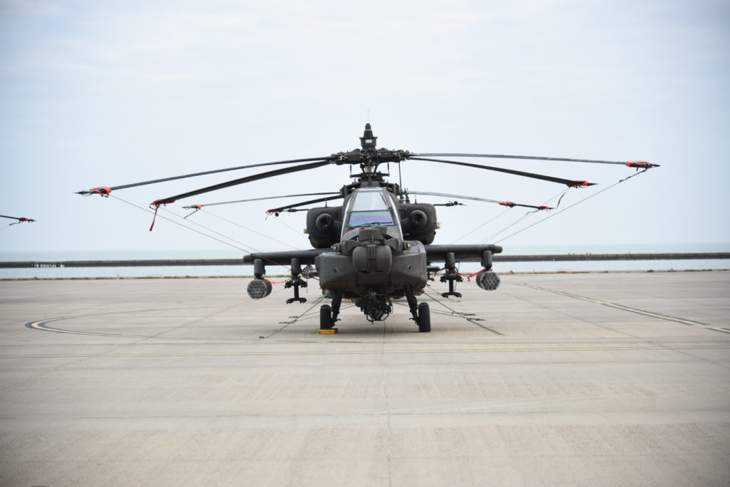This AH-64 Apache with the 1-501st is one month out from its European deployment. It waits with other AH-64 Apaches along the Corpus Christi Army Depot flight line prior to getting loaded on a ship for its transatlantic voyage (Photo Credit: Ms. Kiana W Allen (AMC))