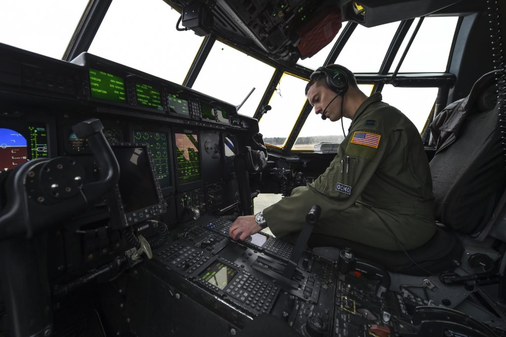 Captain Kyle Gauthier, a 61st Airlift Squadron C-130J Super Hercules pilot and the flight commander, conducts a preflight checklist for a training sortie flight February 3, 2017, at Little Rock Air Force Base, Arkansas. During the flight, aircrews tested the operability of recent hardware and software upgrades (U.S. Air Force photo/Senior Airman Harry Brexel)