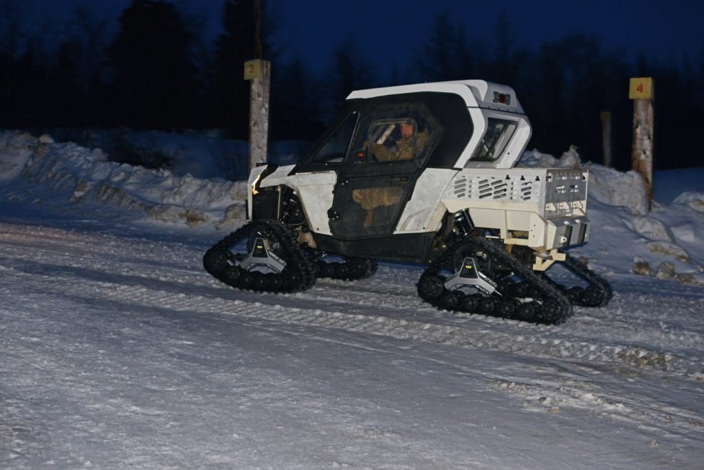 A variety of tracked vehicles like this one are used at NWTC for negotiating steep, snowy terrain. At extreme low temperatures, all vehicles can fail to operate, making reliance on skis and snowshoes a vital skill (Photo Credit: David Vergun)