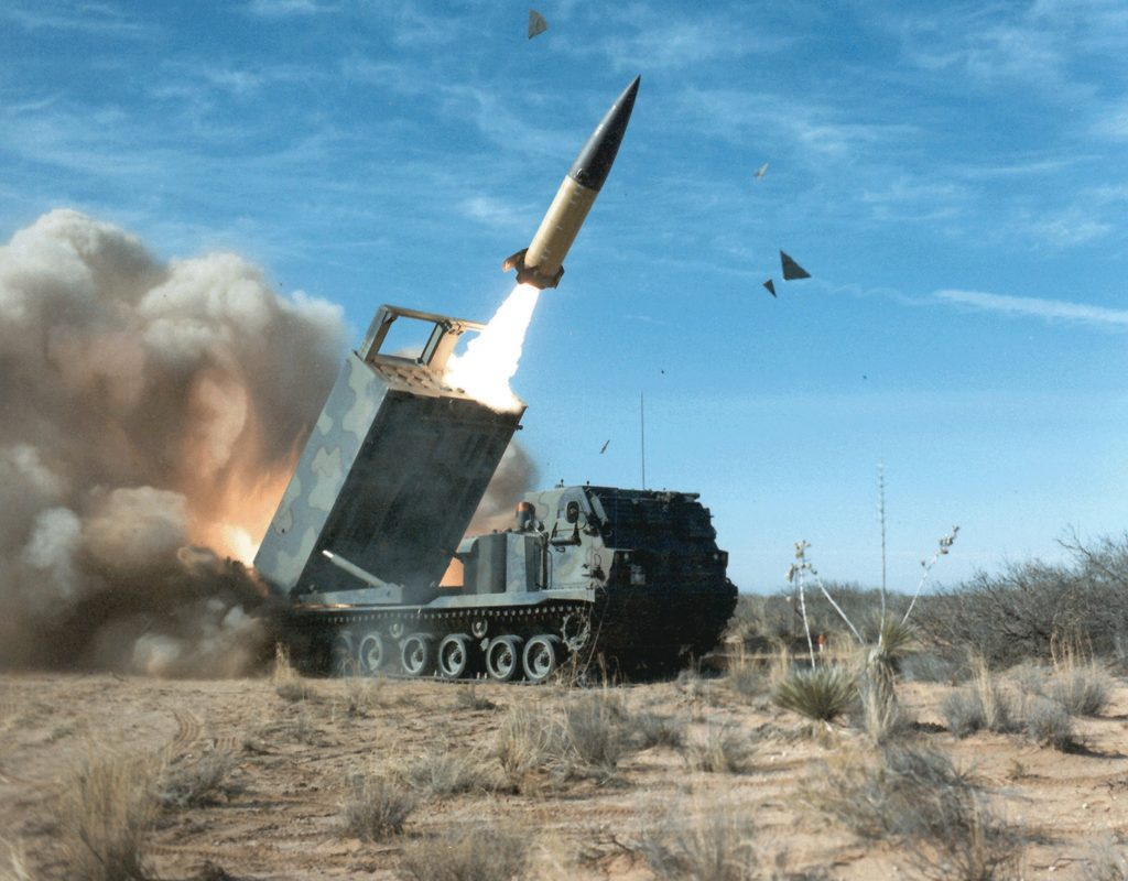 A TACMS long-range missile takes flight from a Lockheed Martin M270A1 launcher during a test