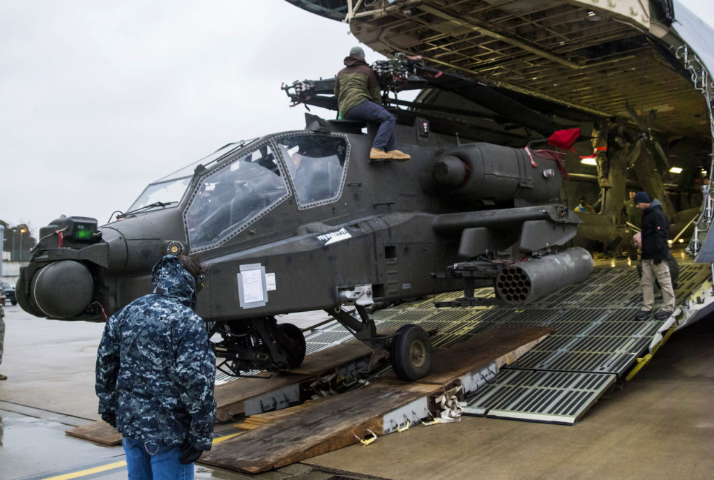 Four Apache helicopters were transported and downloaded from two C-5M Galaxy airplanes at Ramstein Air Base, Germany, February 22. The Apache helicopters came to Europe in support of Operation Atlantic Resolve as part of the United States' commitment to the security of Europe (Photo Credit: Staff Sgt. Tamika Dillard)