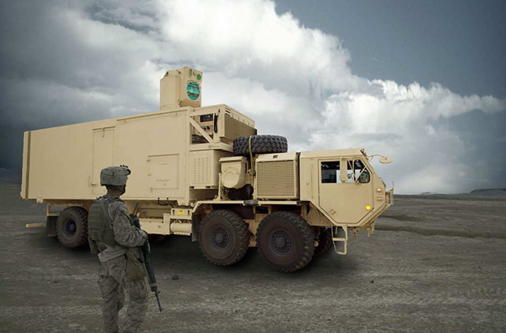 A Soldier stands next to a High-Energy Laser Mobile Test Truck, which is planned to be integrated with a 60-kW laser that successfully completed testing earlier in March. The laser was designed and built by Lockheed Martin, headquartered in Bothell, Washington, and was managed by USASMDC/ARSTRAT Technical Center's High Energy Laser Branch, headquartered at Redstone Arsenal (Photo Credit: U.S. Army)