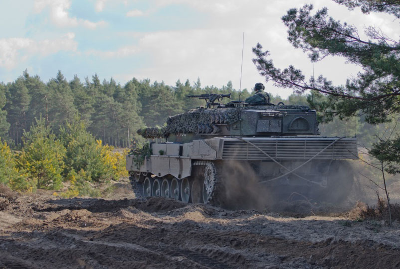A Polish Leopard 2A4 main battle tank leaves its battle position to begin the combined maneuver training at Range Joanna in Karliki, Poland March 15, 2017. Operation Atlantic Resolve provides the opportunity to hone skills and sustain the ability to shoot, move and communicate alongside NATO Allies (Photo Credit: Sergeant Justin Geiger, 7th Mobile Public Affairs Detachment)