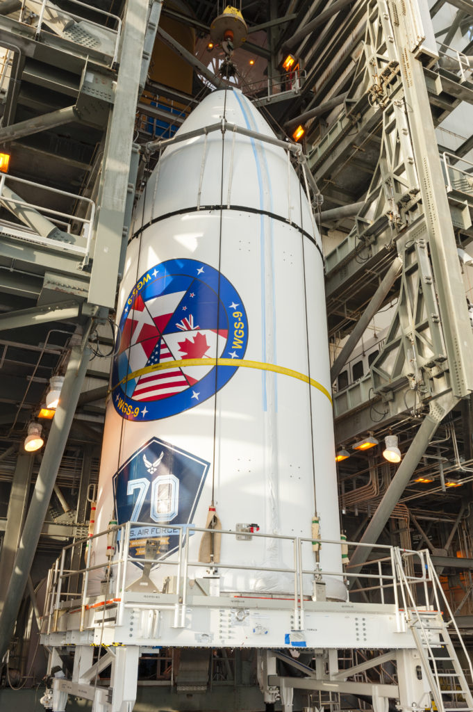 The Air Force's ninth Wideband Global SATCOM (WGS-9) satellite, encapsulated inside a 5-meter payload fairing, is mated to its Delta IV booster inside the Mobile Service Tower at Cape Canaveral's Space Launch Complex-37