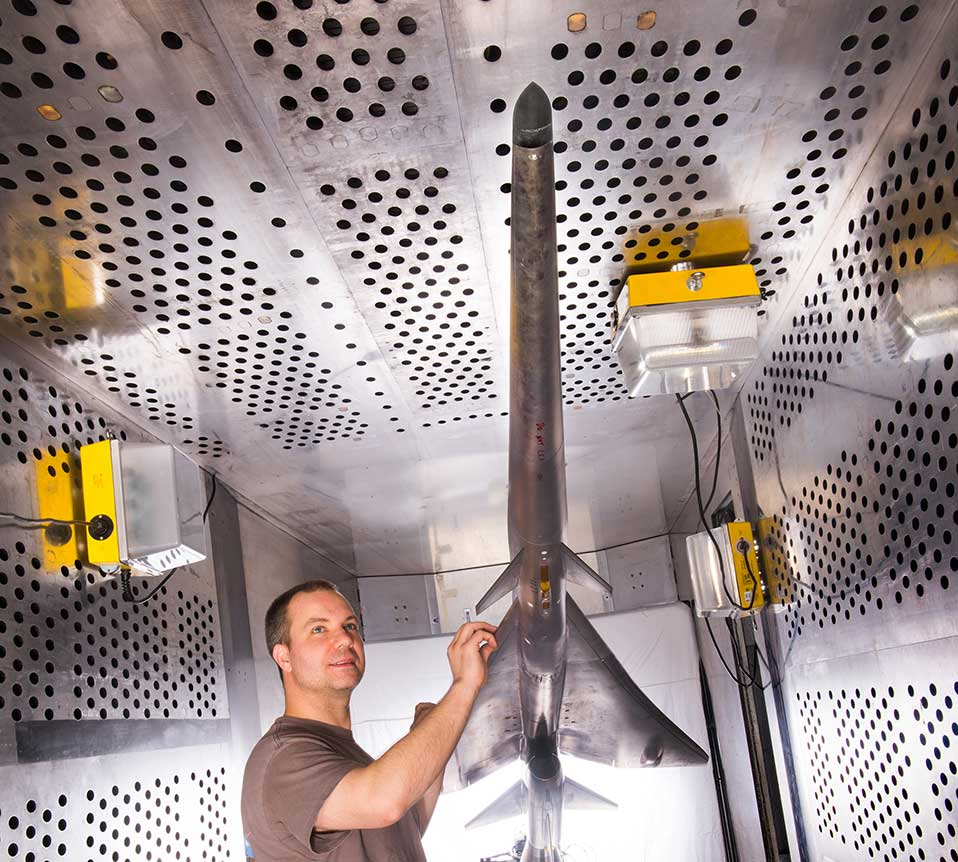 Mechanical technician Dan Pitts prepares the model for wind tunnel testing (Credit: NASA)