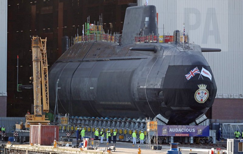 HMS Audacious (S122), an Astute-class nuclear attack submarine, has left the covered hall in Barrow-in-Furness, Cumbria (BAE Systems photo)