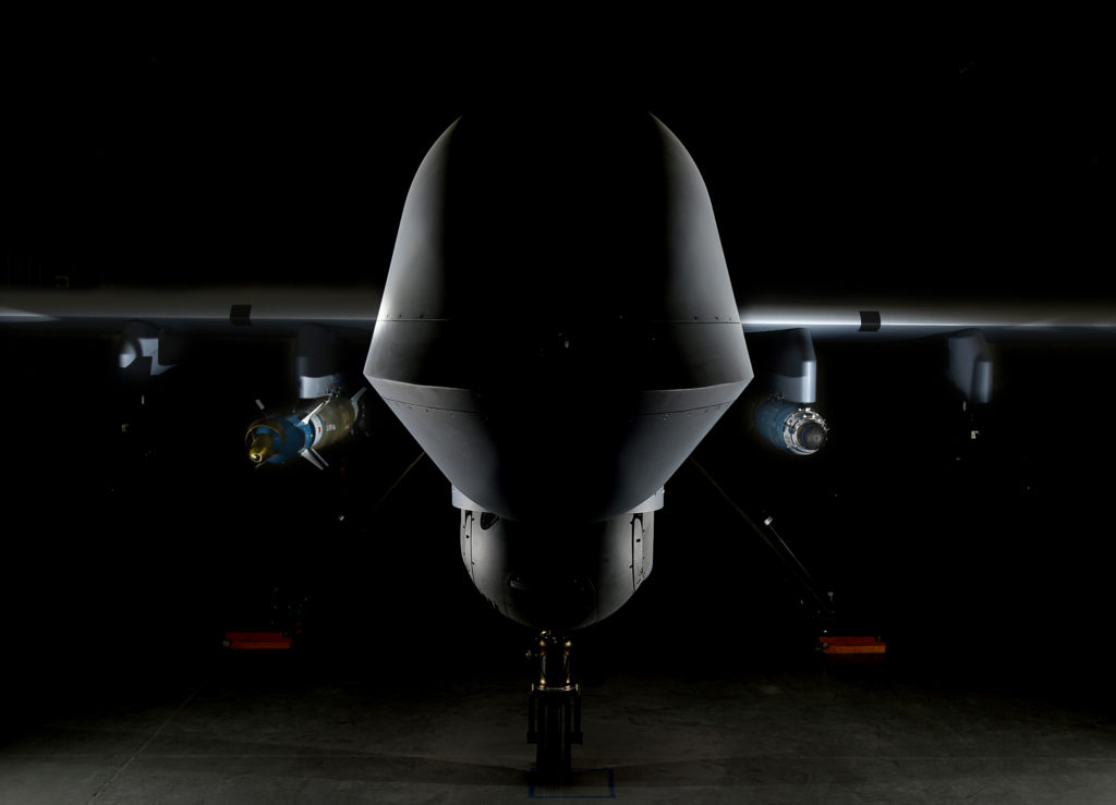An MQ-9 Reaper is loaded with a GBU-12 laser-guided bomb on the left and a GBU-38 Joint Direct Attack Munition on the right April 13, 2017, at Creech Air Force Base, Nevada. The JDAM is a GPS guided munition which brings added capability to the warfighters, specifically by aircrews being able to employ weapons through inclement weather. The first two GBU-38s employed in training successfully hit their targets May 1, 2017, over the Nevada Test and Training Range (U.S. Air Force photo/Senior Airman Christian Clausen)