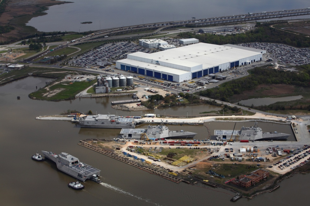 Future USS Tulsa (LCS-16) is heading back to Austal USA after launching from the drydock at BAE Ship Systems. She's passing Austal's vessel completion yard where USNS Yuma (EPF-8), future USS Gabrielle Giffords (LCS-10) and future USS Omaha (LCS-12) are docked (Courtesy photo by USA Austal)