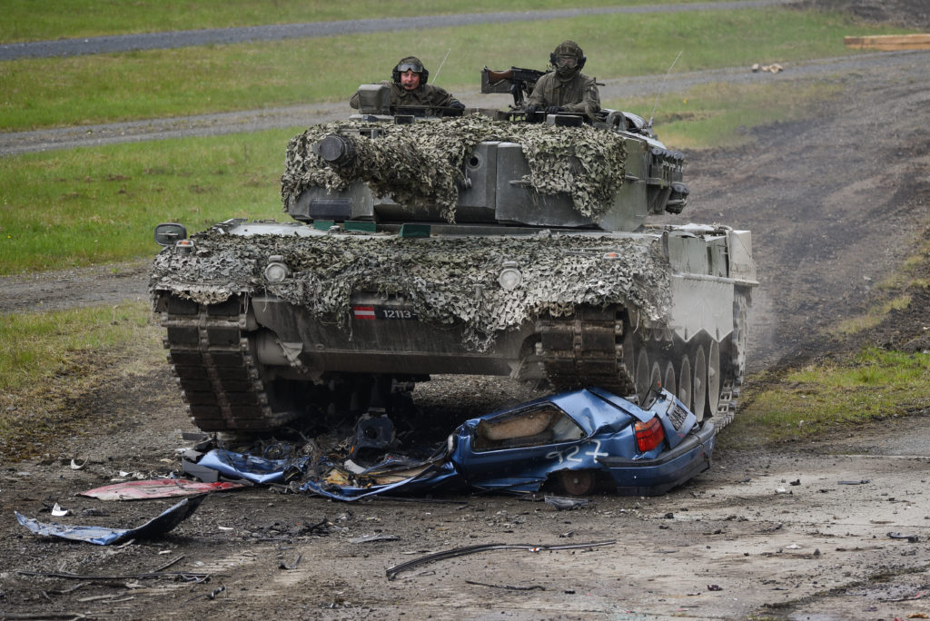 An Bundesheer (Austrian Armed Forces) Leopard 2A4 tank crushes car as part of the precision driving lane, during the Strong Europe Tank Challenge at the 7th Army Training Command's Grafenwoehr Training Area (Photo Credit: Spc. Nathanael Mercado)