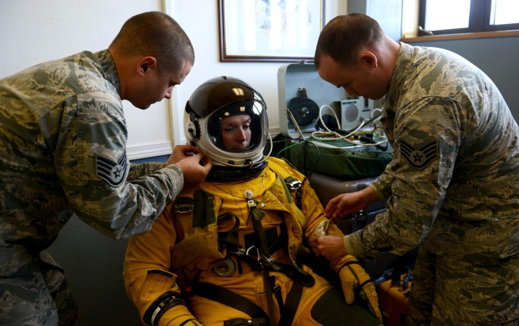 Launch and recovery technicians from the 9th Physiological Support Squadron conduct a preflight inspection on a full-pressure suit at Joint Base Elmendorf-Richardson, Alaska, May 8, 2017. The U-2S Dragon Lady participated for the first time in exercise Northern Edge, which is a joint exercise that involves over 200 fixed-wing aircraft (Air Force photo by Staff Sergeant Jeffrey Schultze)