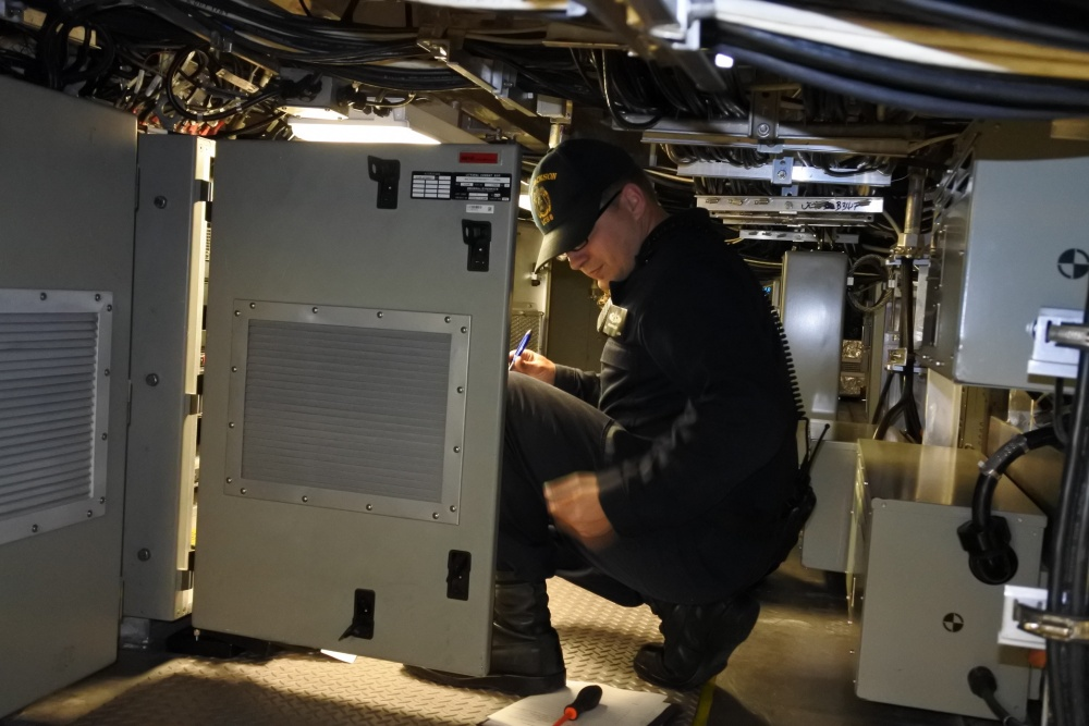 Fire Controlman 1st Class Niklaus Pegler, from Monette, Arkansas, conducts an inspection of the multi-function racks aboard Independence-variant littoral combat ship USS Jackson (LCS-6) during Final Contract Trials (FCT) (U.S. Navy photo by Fire Controlman 1st Class Christopher J. Bright)