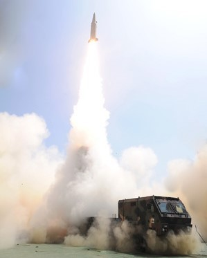 A Hyunmoo ballistic missile with a maximum range of 497 miles/800 kilometers is launched from a mobile launch vehicle during a test-firing observed by South Korean President Moon Jae-on June 23