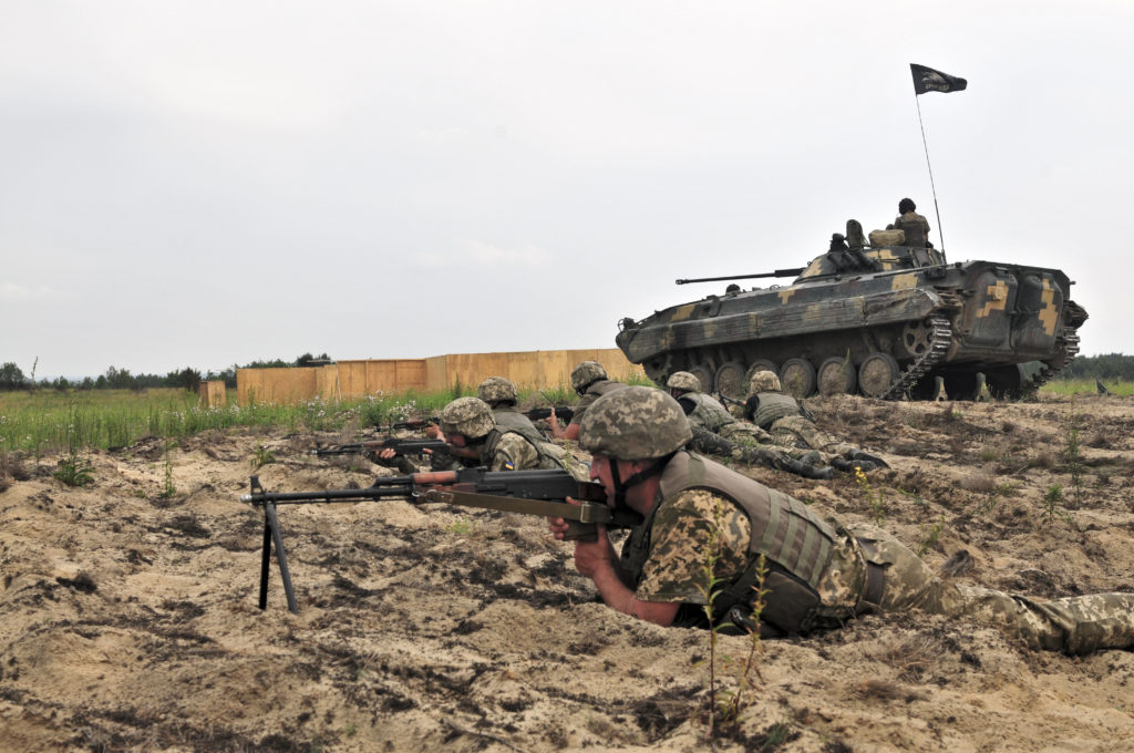 A BMP-2 provides support by fire to Ukrainian infantry during a platoon live-fire on June 23, 2016 at the International Peacekeeping and Security Center near Yavoriv. The location is also the site of a new combat training center, developed with assistance from the 79th Infantry Brigade Combat Team out of the California National Guard. It's expected that by 2018, the Ukrainian ground forces will be able to put brigade-sized elements through training at the CTC (Photo Credit: Captain Scott Kuhn)