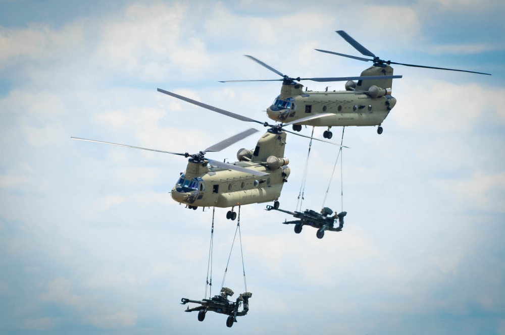 In the Multi-Domain Battle concept, howitzers might one day protect U.S. ships from enemy vessels by firing anti-ship projectiles. Shown here, two CH-47 Chinook helicopters assigned to 3rd General Support Aviation Battalion, 82nd Combat Aviation Brigade, 82nd Airborne Division perform tactical maneuvers to place two M777A2 Howitzer's in position for onlookers during the 82nd ABN Division All-American Week Airborne Review on Sicily Drop Zone at Fort Bragg, N.C., May 25, 2017 (Photo Credit: U.S. Army photo by Sergeant Steven Galimore)