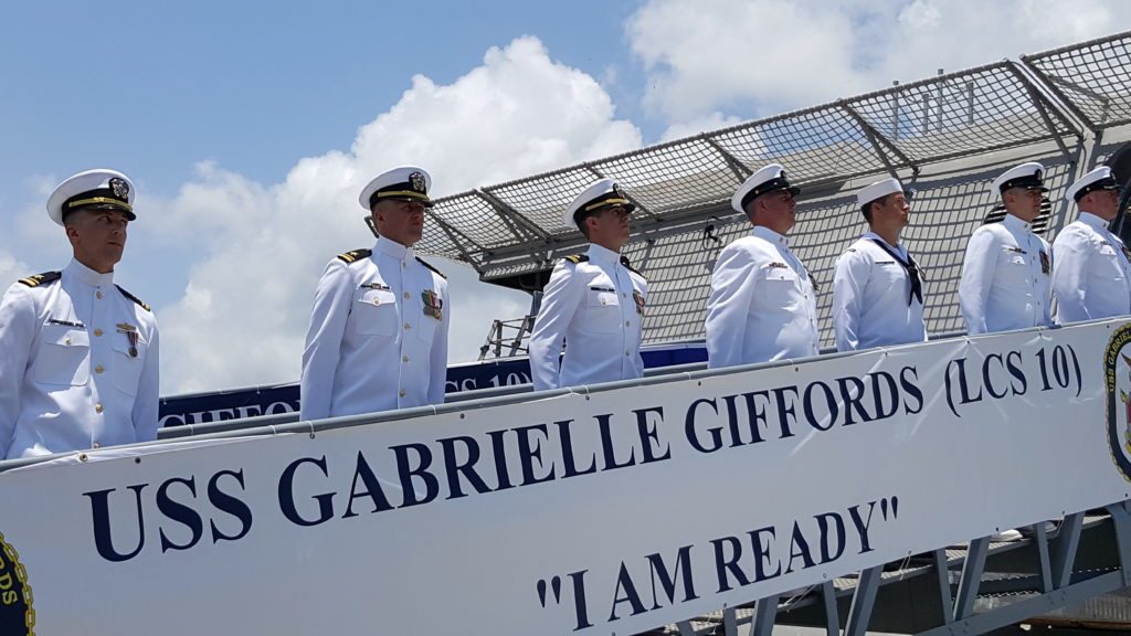 The crew of the newest littoral combat ship USS Gabrielle Giffords (LCS-10) «mans the ship and brings her to life» during a commissioning ceremony held in the Port of Galveston, Texas (U.S. Navy photo by Senior Chief Mass Communication Specialist Michael D. Mitchell/Released)
