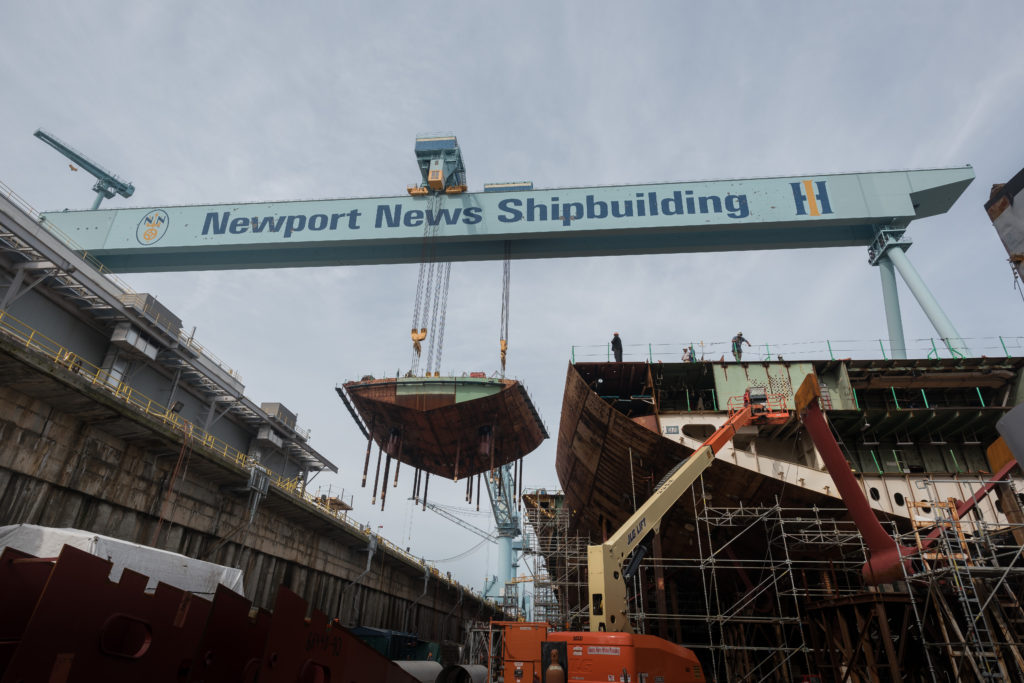 Shipbuilders at Newport News Shipbuilding lifted the lower stern of CVN-79 into place