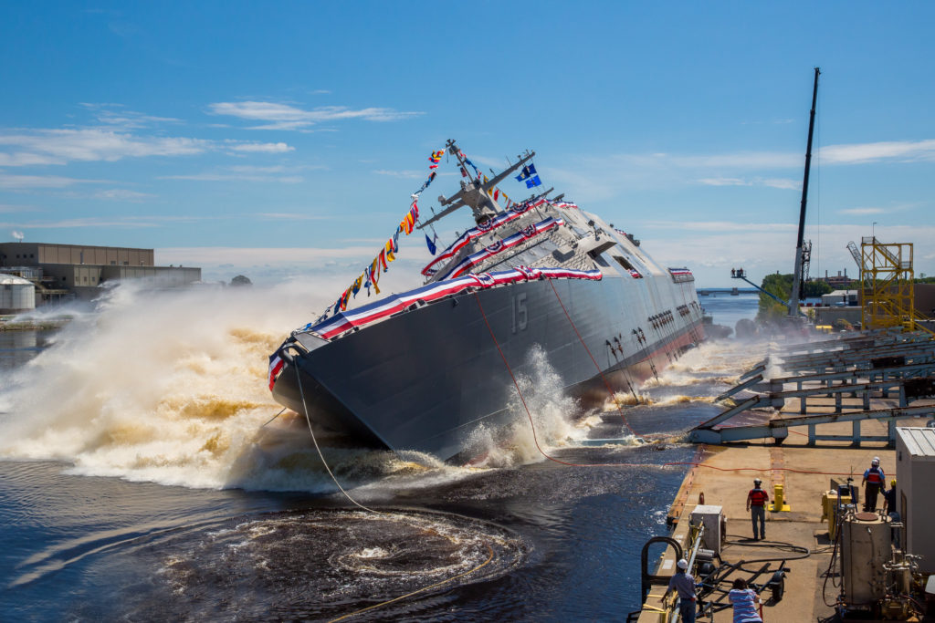 The U.S. Navy's future USS Billings (LCS-15) launches sideways into the Menominee River in Marinette, Wisconsin, following its christening by ship sponsor Sharla Tester. Once commissioned, LCS-15 will be the first ship of its name in naval service (U.S. Navy photo courtesy of Lockheed Martin/Released)