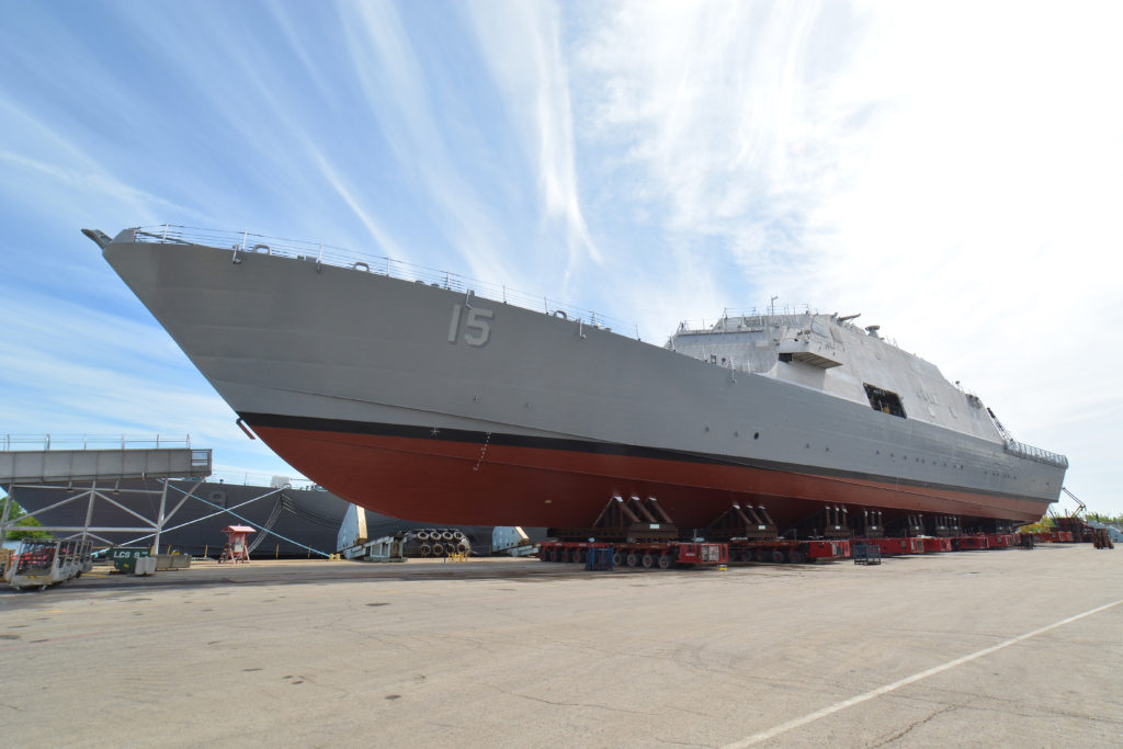 The 15th littoral combat ship, the future USS Billings (LCS 15) is pictured next to the Menominee River ahead of its christening July 1, 2017. Once commissioned, LCS-15 will be the first ship of its name in naval service (U.S. Navy photo courtesy of Lockheed Martin/Released)