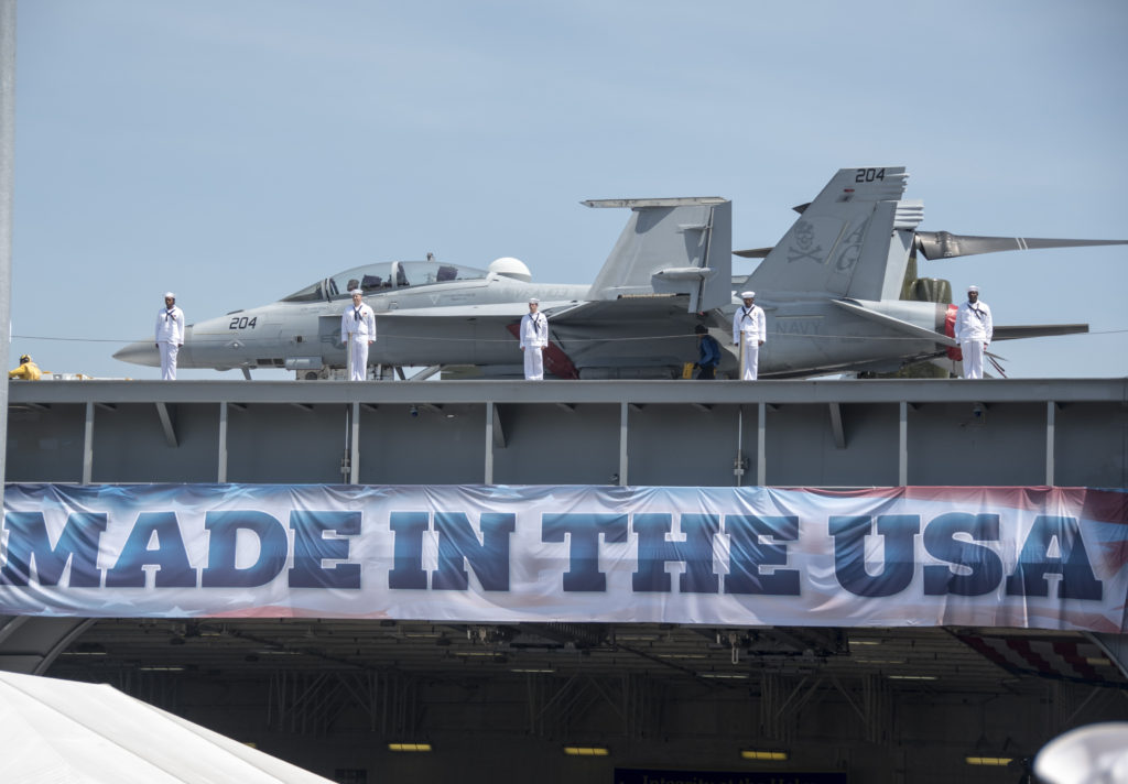Sailors man the rails of the aircraft carrier USS Gerald R. Ford (CVN-78) during its commissioning ceremony at Naval Station Norfolk, Virginia (U.S. Navy photo by Mass Communication Specialist 2nd Class Andrew J. Sneeringer)